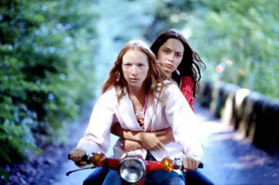 Mona and Tamsin look serious on the moped